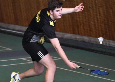 Boy- wearing black playing badminton