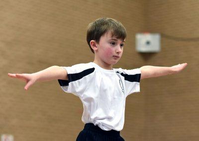 Young boy doing gymnastics routine