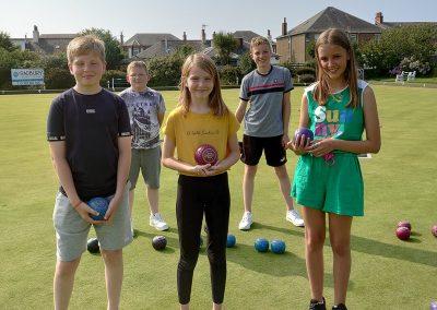 School children standing on bowling green